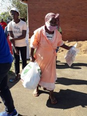 Gogo collecting food parcel