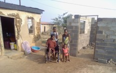 Zanele & family with house