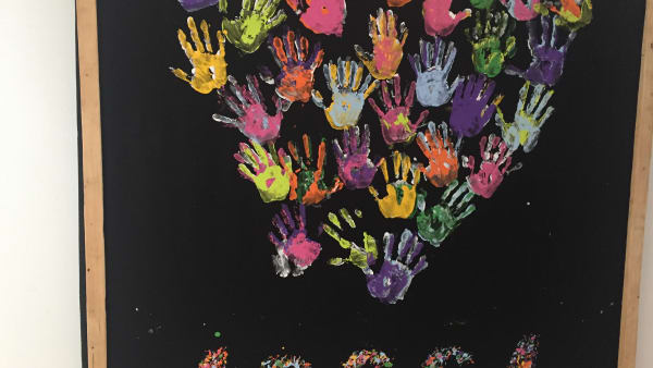 Handprint heart with Mandela prisoner number for AIDS awareness